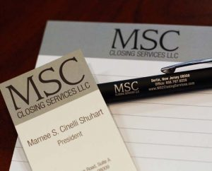 MSC Closing Services buisness card, notepad, and pen